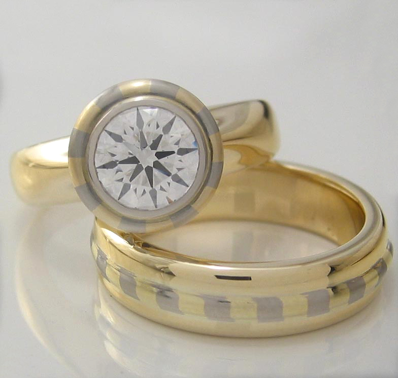 Handmade ladies 18ct yellow and white gold striped engagement and wedding ring set featuring a 0.82ct EightStar diamond