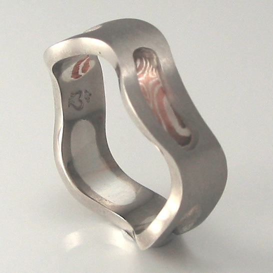 Handmade gents 18ct white gold wedding ring featuring copper and sterling silver Mokume Gane inserts