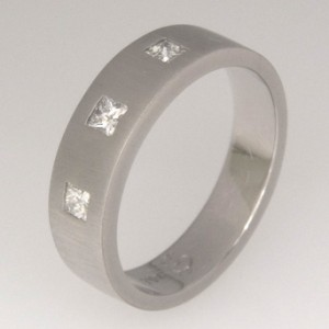 Handmade 18ct white gold flush set princess cut wedding ring featuring a matte finish