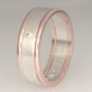 Handmade 9ct white gold and rose gold ring featuring flush set diamonds.