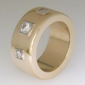 Handmade 18ct yellow gold band with three grain set brilliant cut diamonds.