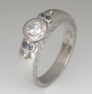 Handmade ladies platinum brilliant cut diamond and sapphire engagement ring
