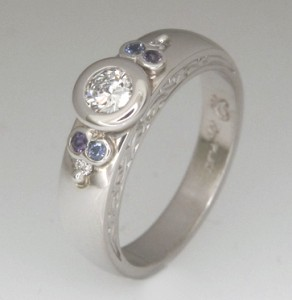 Handmade ladies platinum brilliant cut diamond and sapphire engagement ring