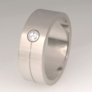 Handmade gents 18ct white gold wedding ring featuring a Spirit cut diamond