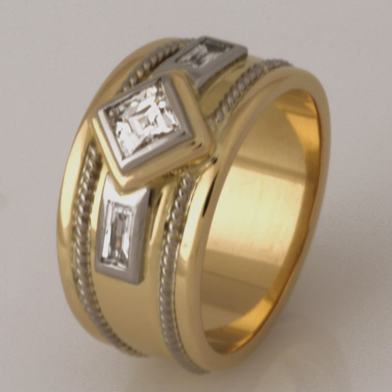 Handmade ladies 18ct white and yellow gold 'Tycoon' cut diamond ring