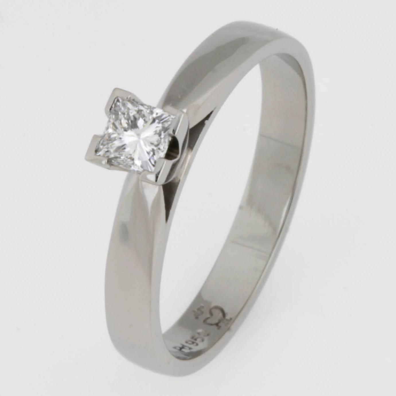Handmade ladies engagement ring featuring a princess cut diamond