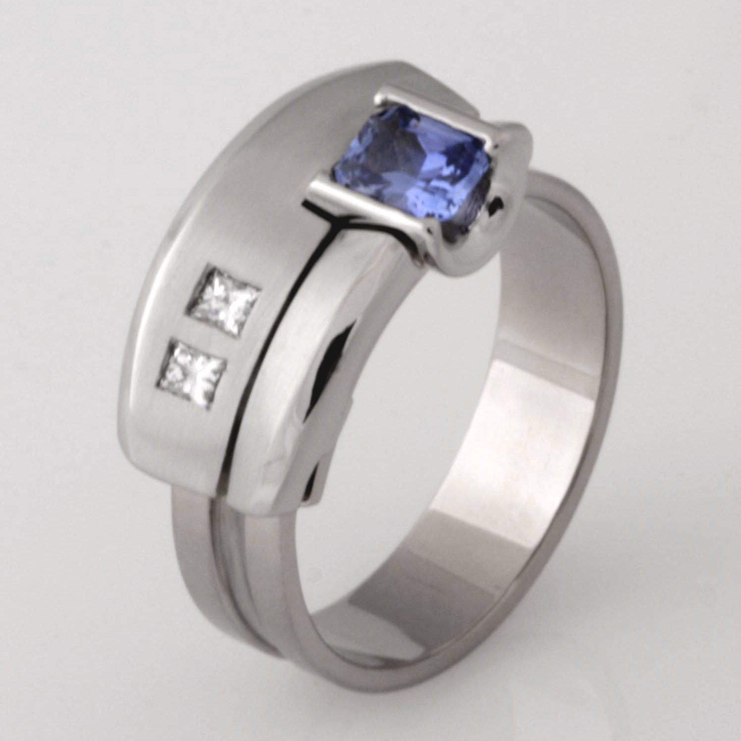 Handmade 18ct white gold and palladium Archie style ring featuring diamonds and Ceylon sapphire
