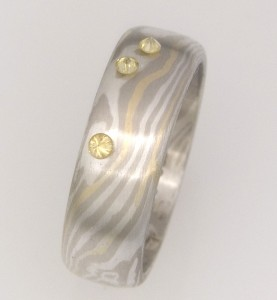 Handmade 18ct yellow gold, white gold and sterling silver Mokume Gane ring featuring yellow diamonds