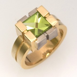 Handmade ladies 18ct yellow and white gold ring featuring a Context cut peridot