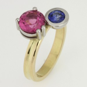 Handmade ladies 18ct yellow gold and palladium ring featuring a rubelite and sapphire.