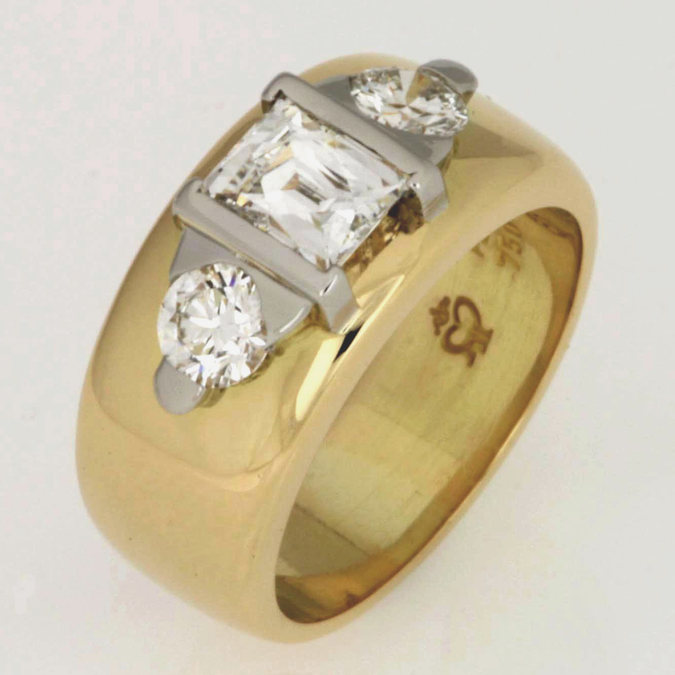 Handmade ladies 18ct yellow gold wedding band featuring a Tycoon Cut diamond and round diamonds set in platinum