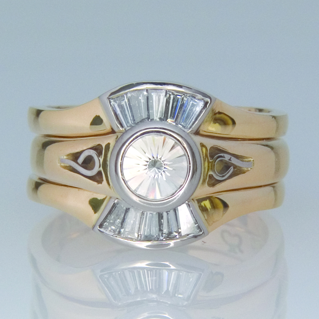 Handmade 18ct yellow gold ring set featuring a 'Spirit' diamond bezel set in white gold and a matching wedding and eternity ring featuring channel set tapered baguette diamonds.