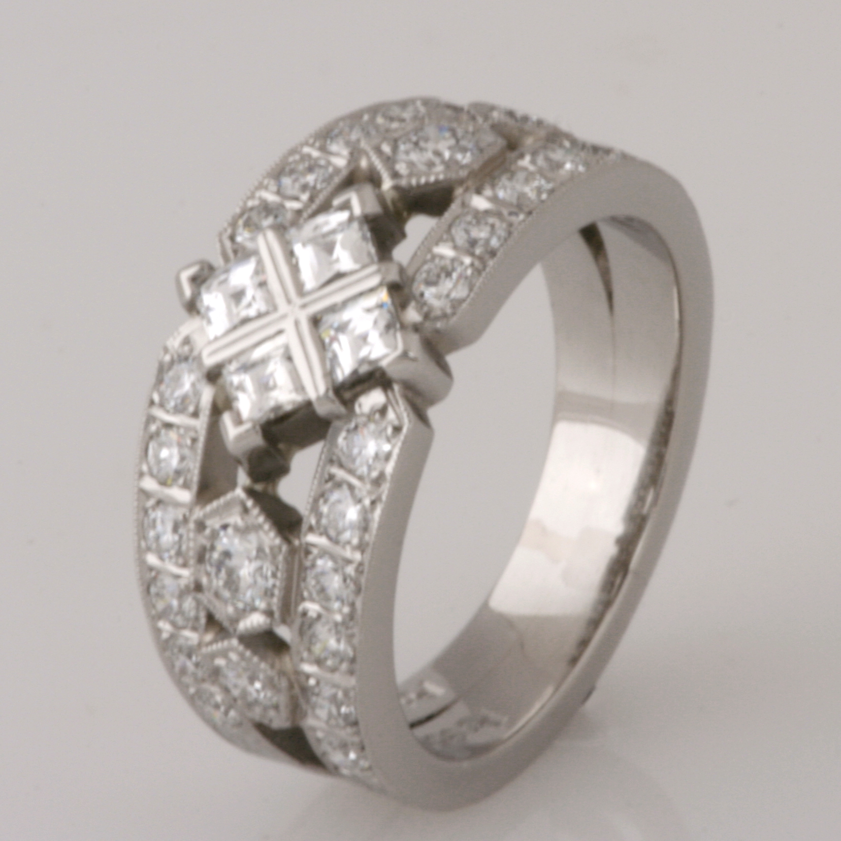 Handmade ladies palladium engagement ring with 'Tycoon' cut diamonds and brilliant cut diamonds