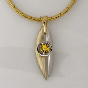 Handmade 18ct yellow and white gold Mokume Gane and palladium pendant featuring a yellow 'Spirit' cut sapphire