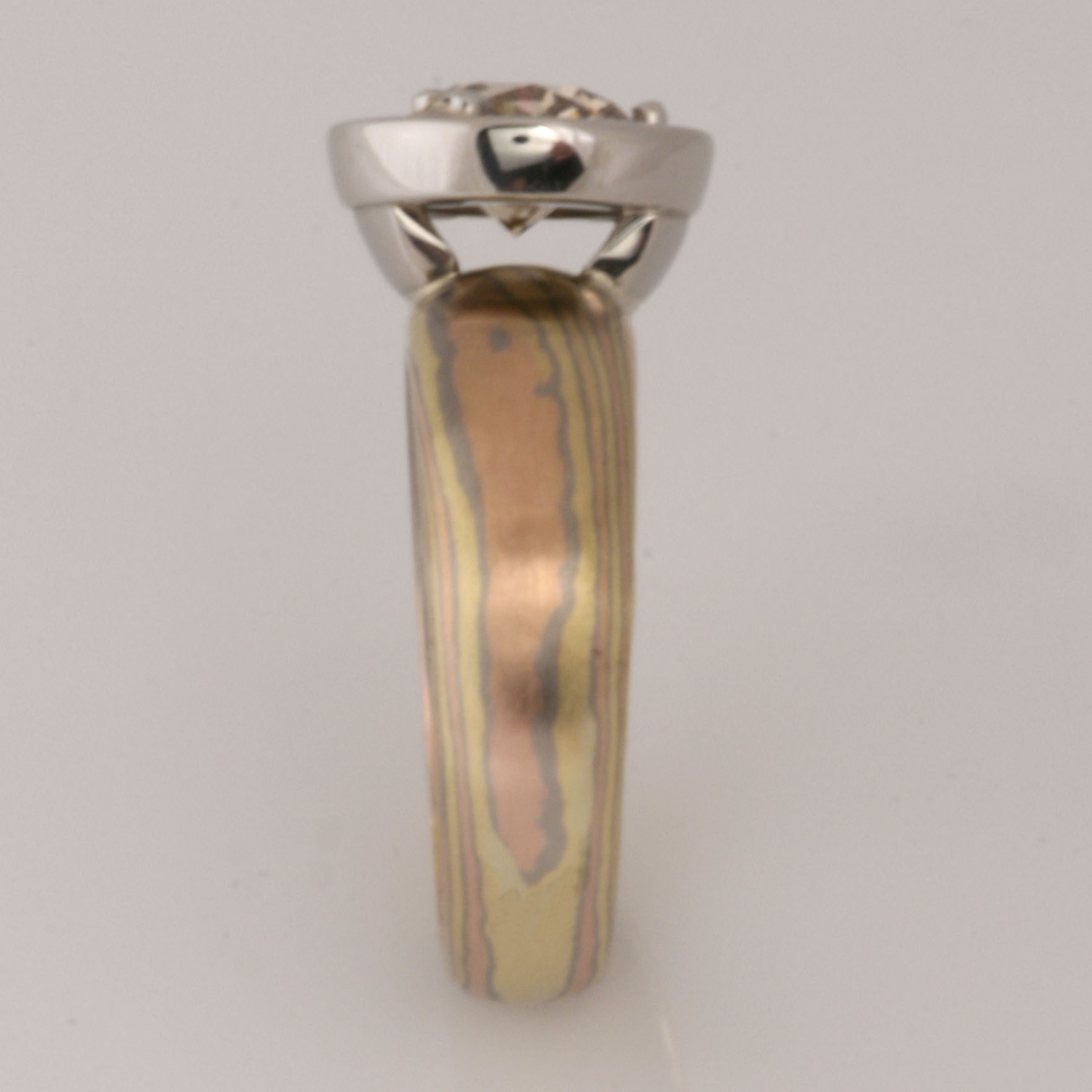 Handmade ladies green, rose and white gold and palladium Mokume Gane Champagne diamond engagement ring