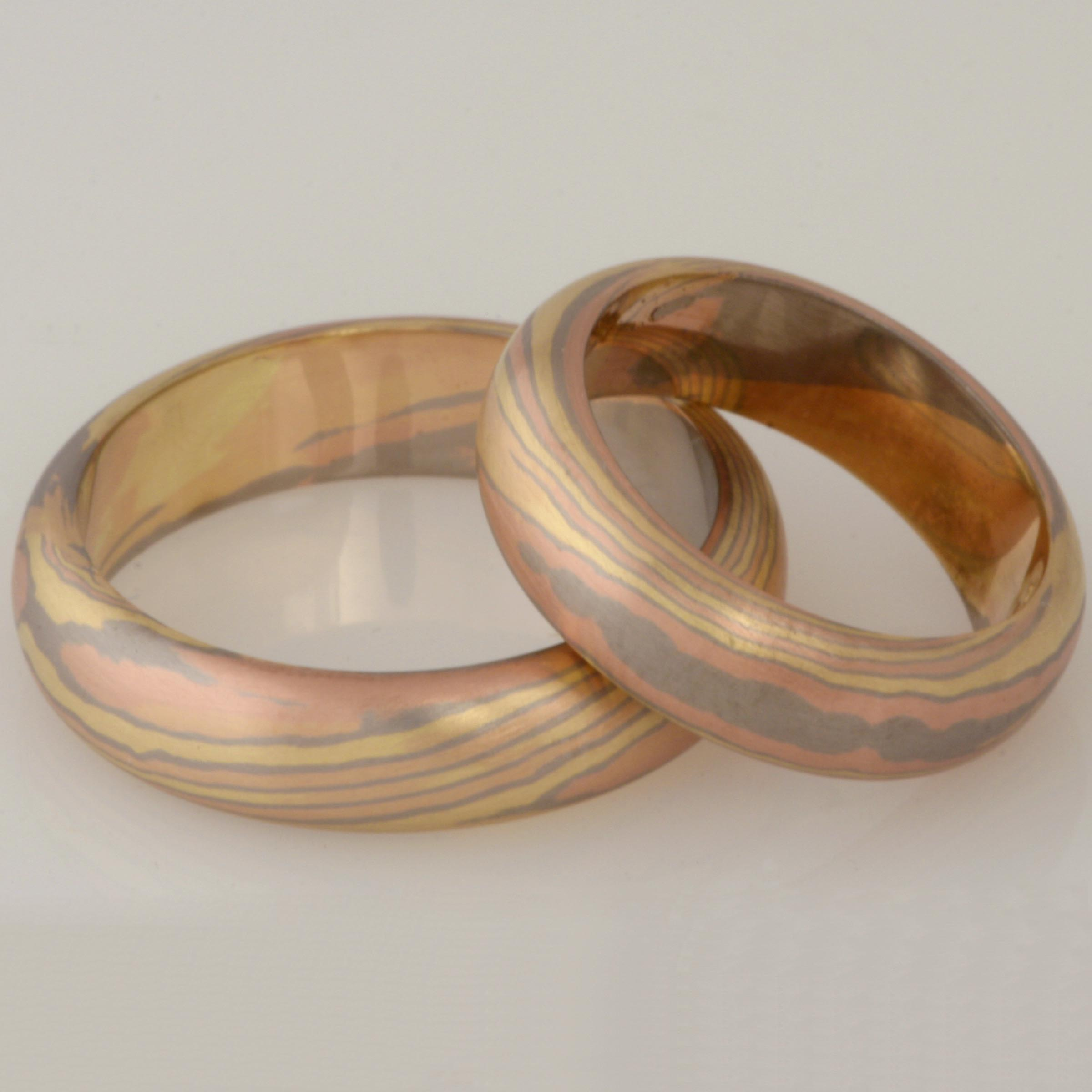 Handmade ladies and gents green, rose and white gold Mokume Gane wedding rings
