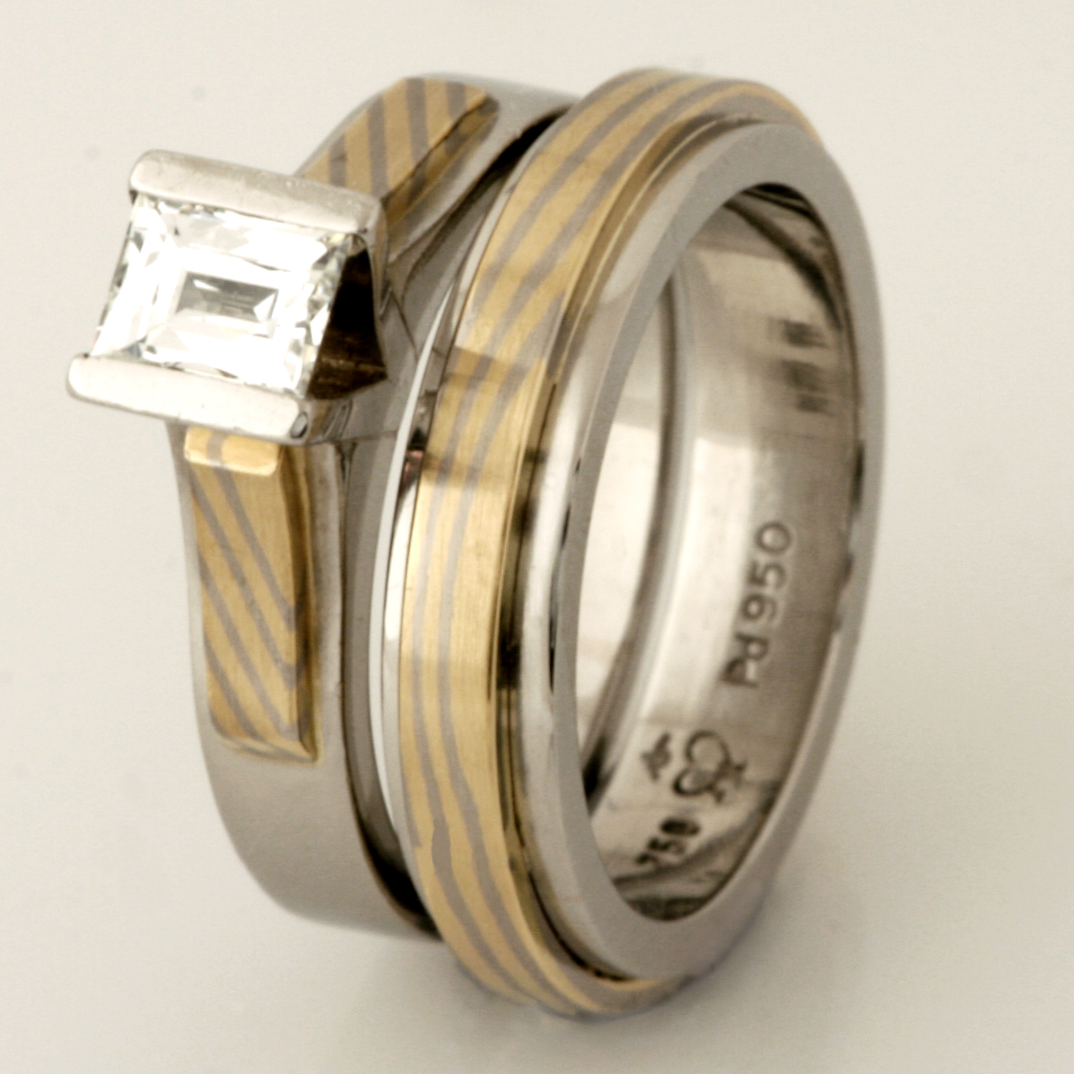 Handmade ladies palladium engagement and wedding ring featuring an 18ct yellow gold and 18ct white gold Mokume Gane band