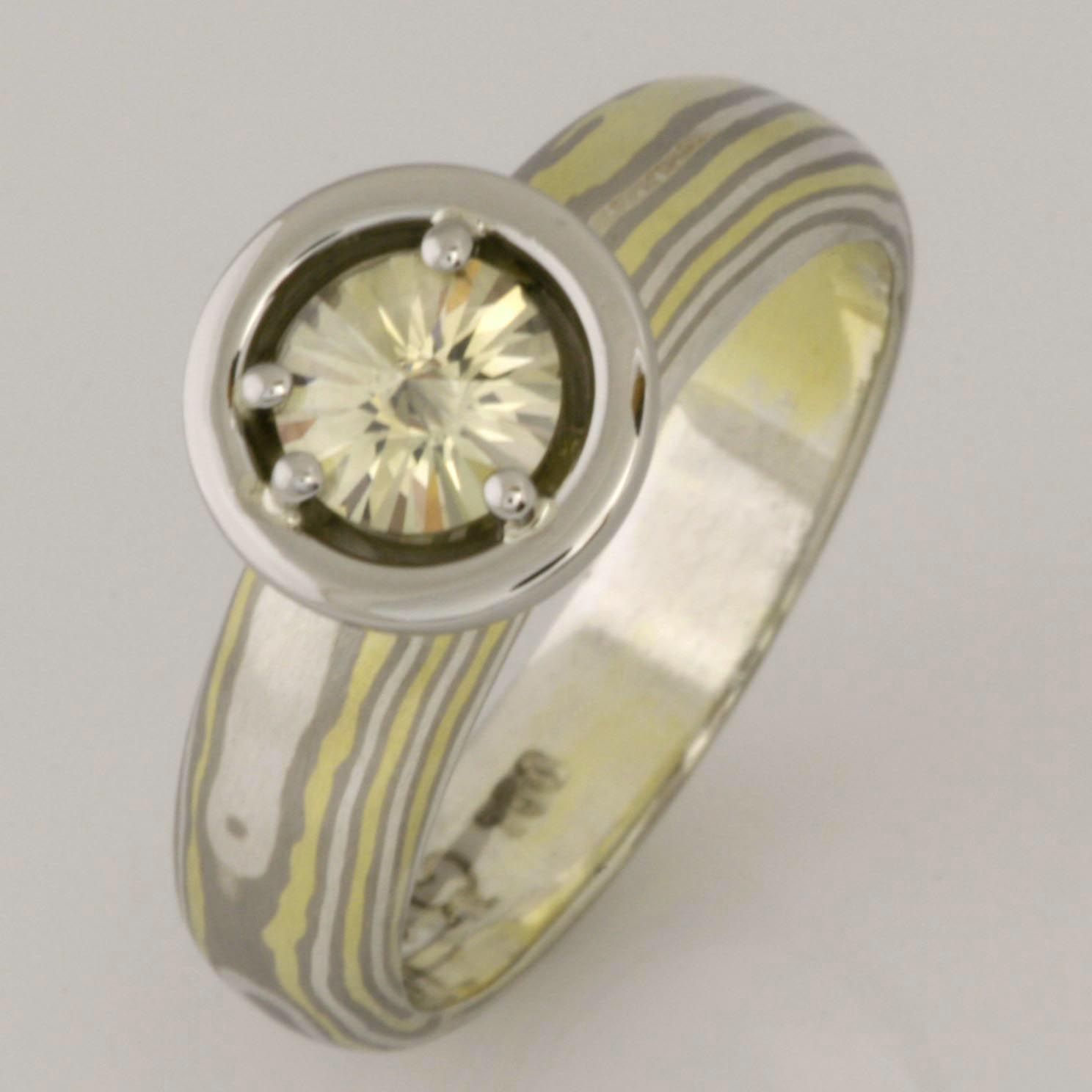 Handmade 18ct green gold, white gold and sterling silver ladies Mokume Gane ring with a Light Green coloured 'Spirit' cut diamond