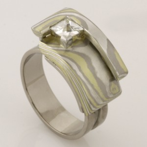 Handmade ladies 18ct white & green gold and sterling silver Mokume Gane Archie ring featuring a context diamond