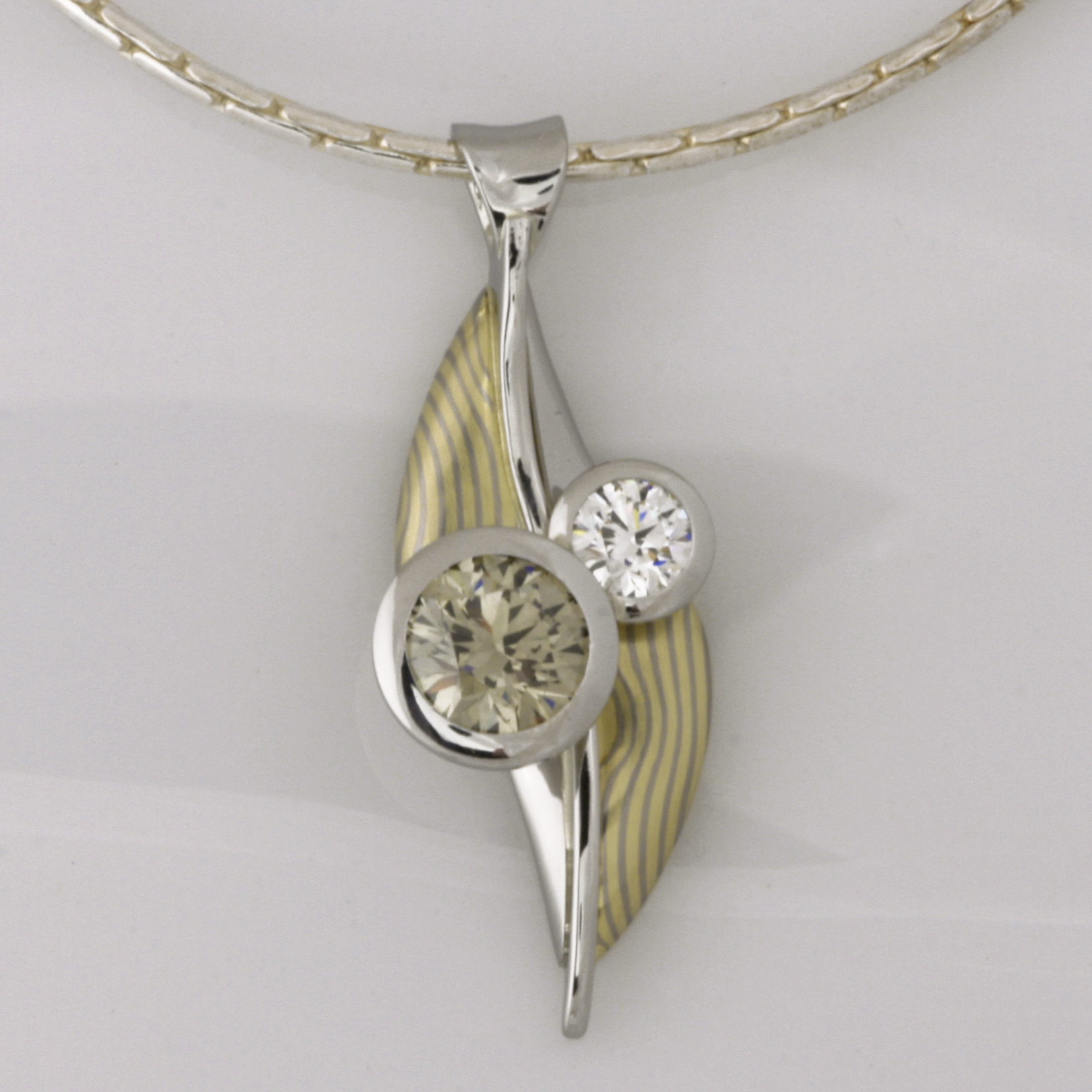 Handmade platinum and 18ct green and white gold Mokume Gane with one green and white EightStar diamond pendant
