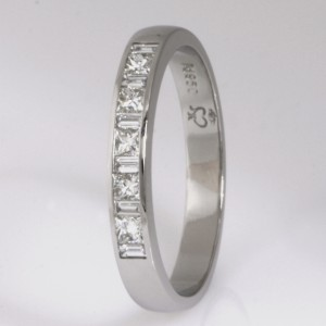 Handmade ladies palladium princess cut diamond set wedding ring.