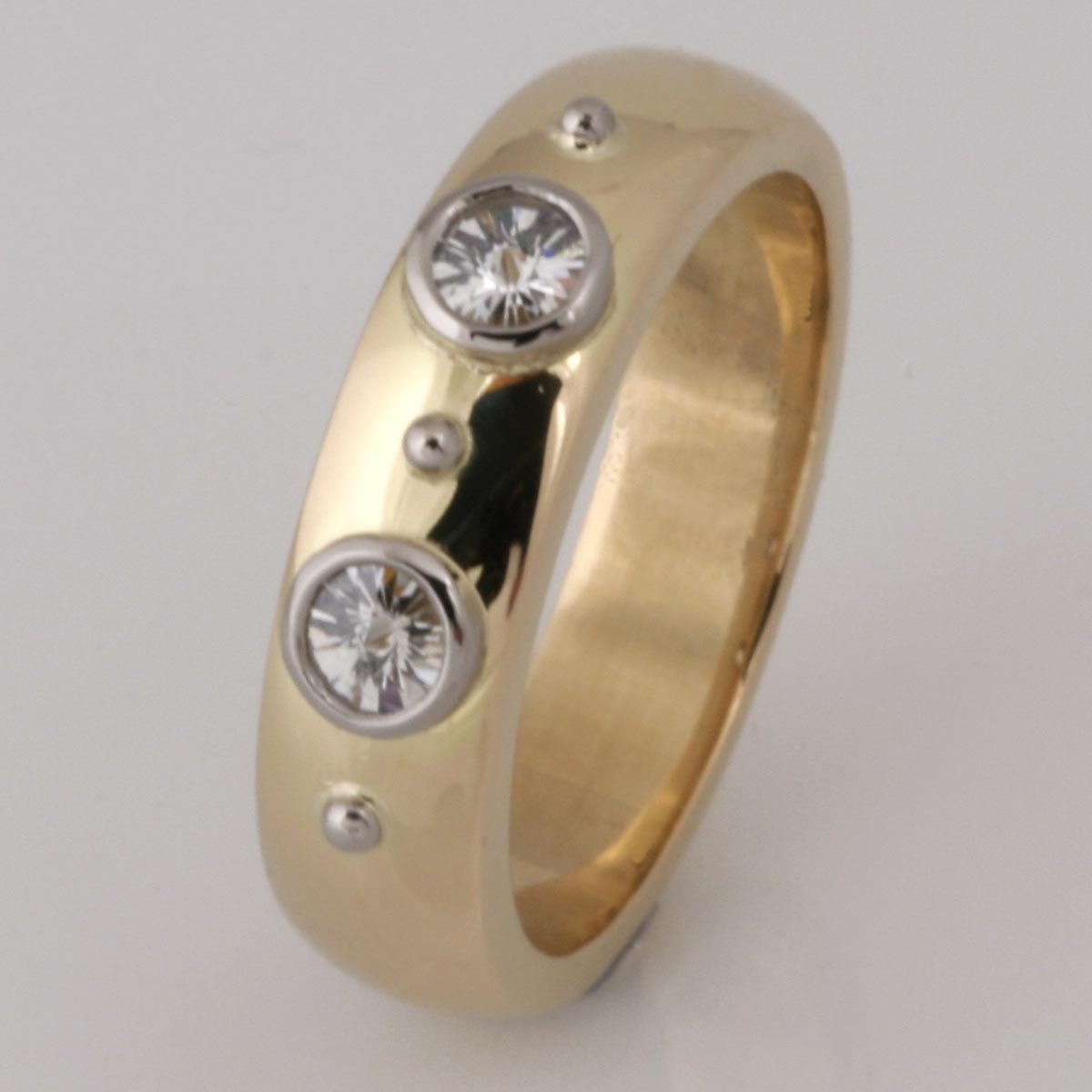 Handmade ladies 18ct yellow and white gold 'Sprirt' cut diamond wedding ring