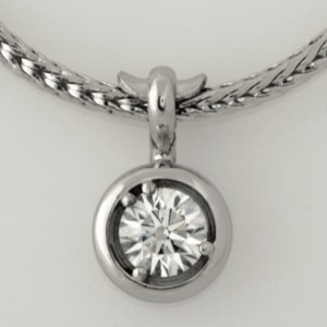 Handmade 18ct white gold pendant featuring an EightStar diamond
