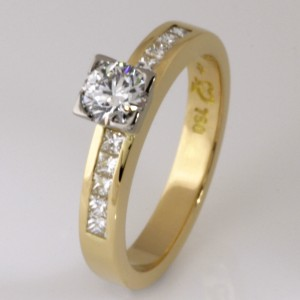 Handmade ladies 18ct yellow gold and palladium engagement ring featuring an Asteios diamond and square princess cut diamonds