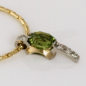 Handmade ladies 18ct yellow gold and palladium peridot and diamond pendant featrued on an 18ct yellow gold chain
