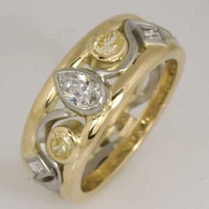 Handmade ladies 18ct yellow gold and palladium ring featuring yellow and white diamonds