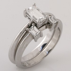Handmade ladies platinum emerald cut diamond wedding ring