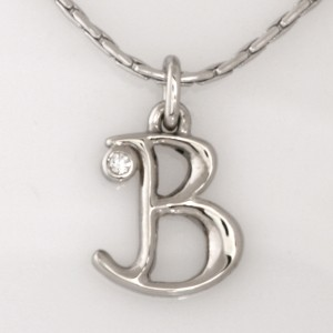 Handmade ladies palladium diamond pendant featured on a 14ct white gold chain