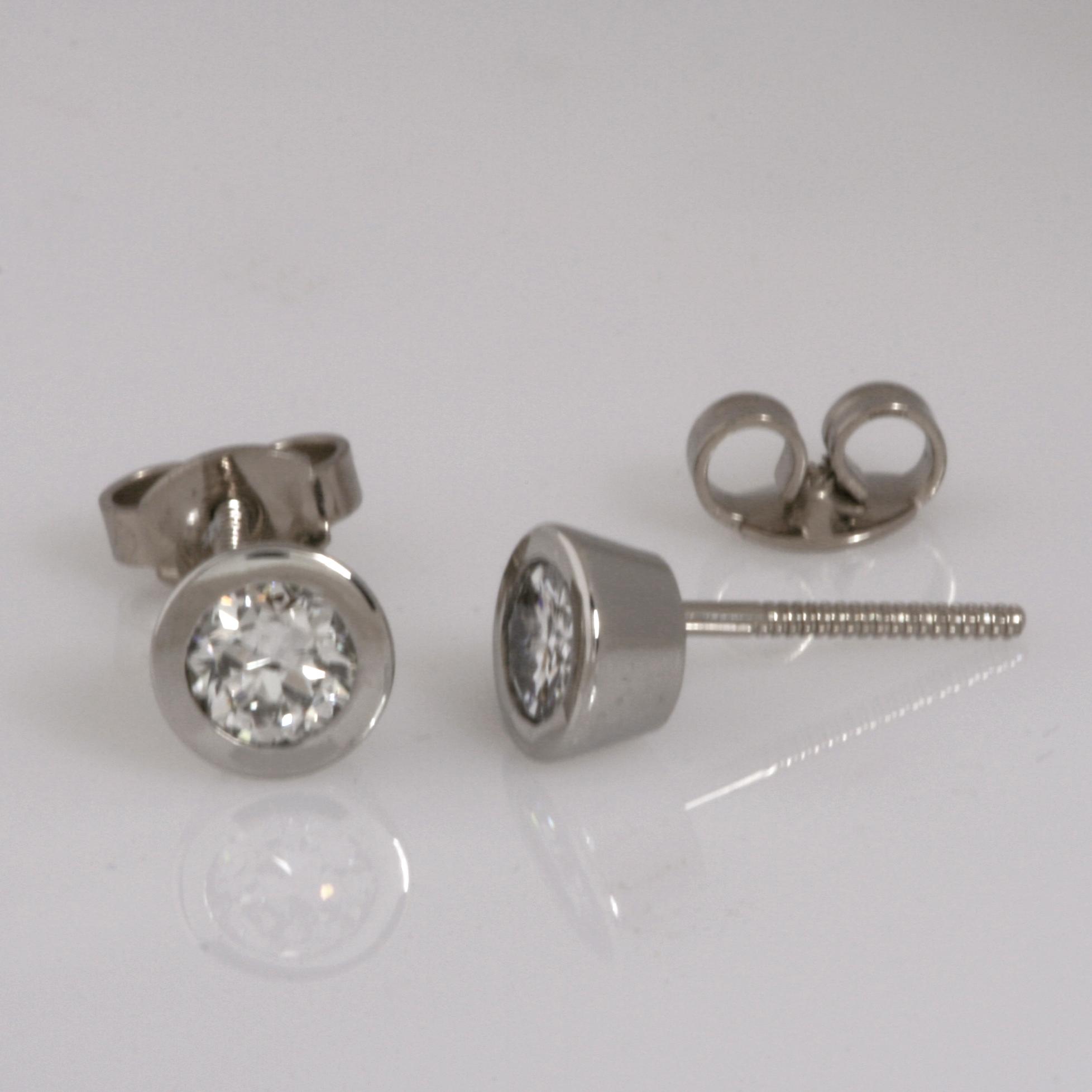 Handmade ladies palladium and 18ct white gold brilliant cut diamond earrings