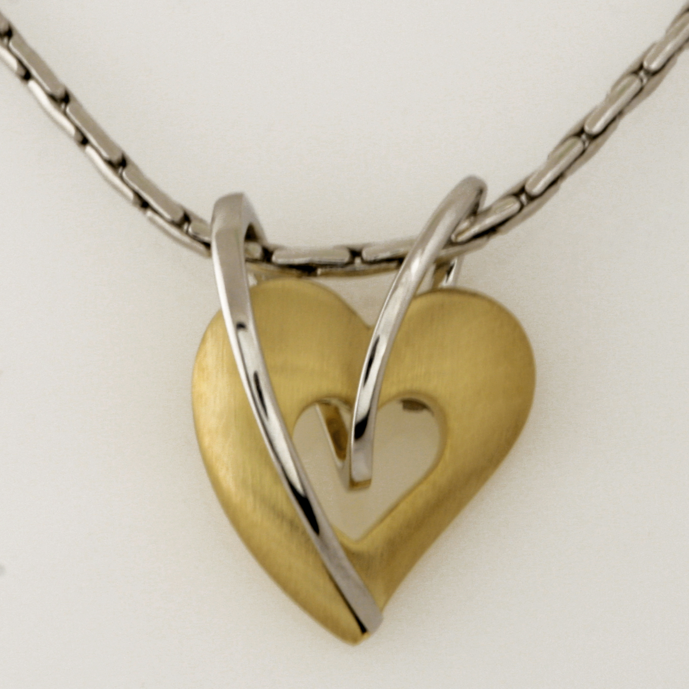 P072 9ct yellow and white gold heart pendant $410