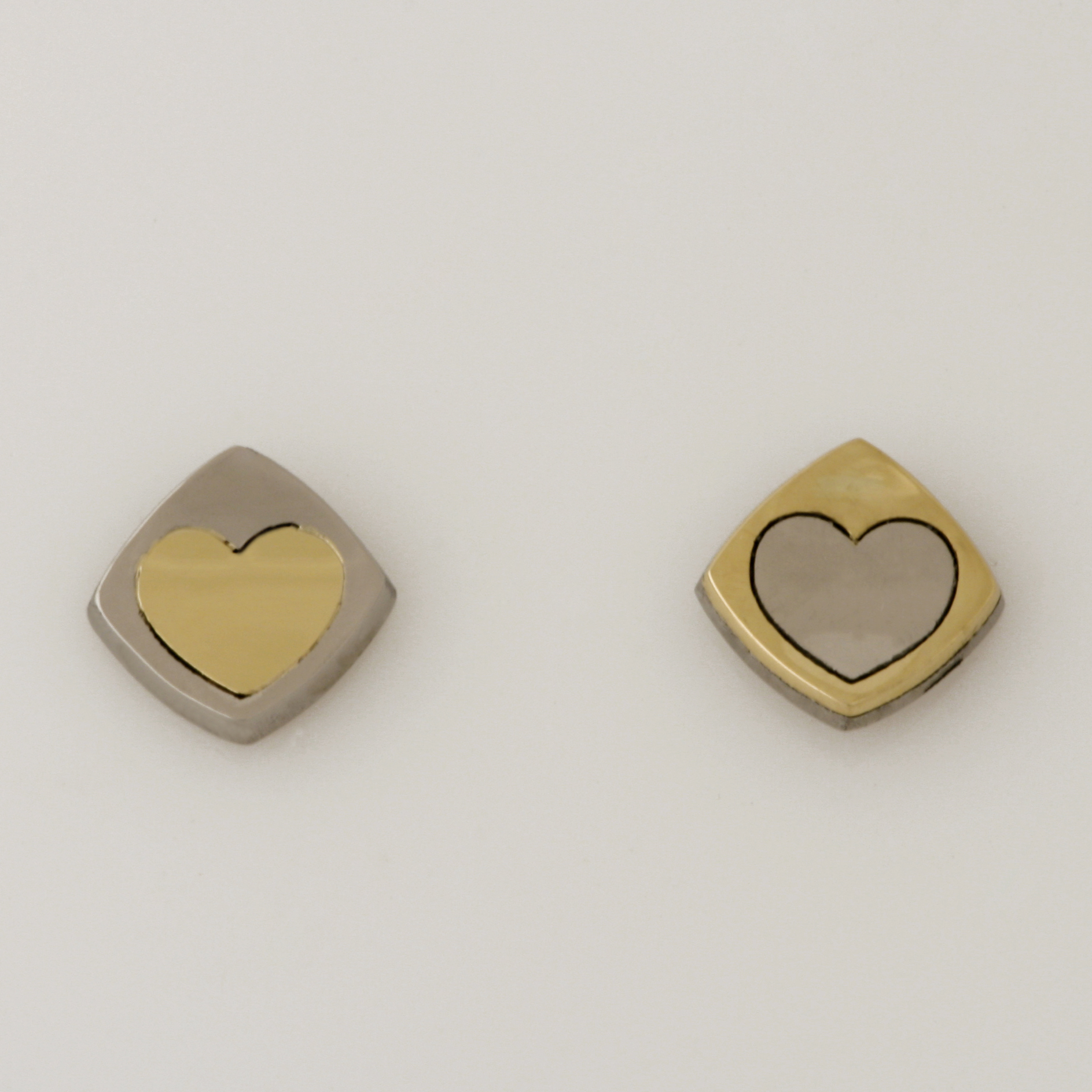 'PLAY' heart earrings made in palladium and 18ct yellow gold