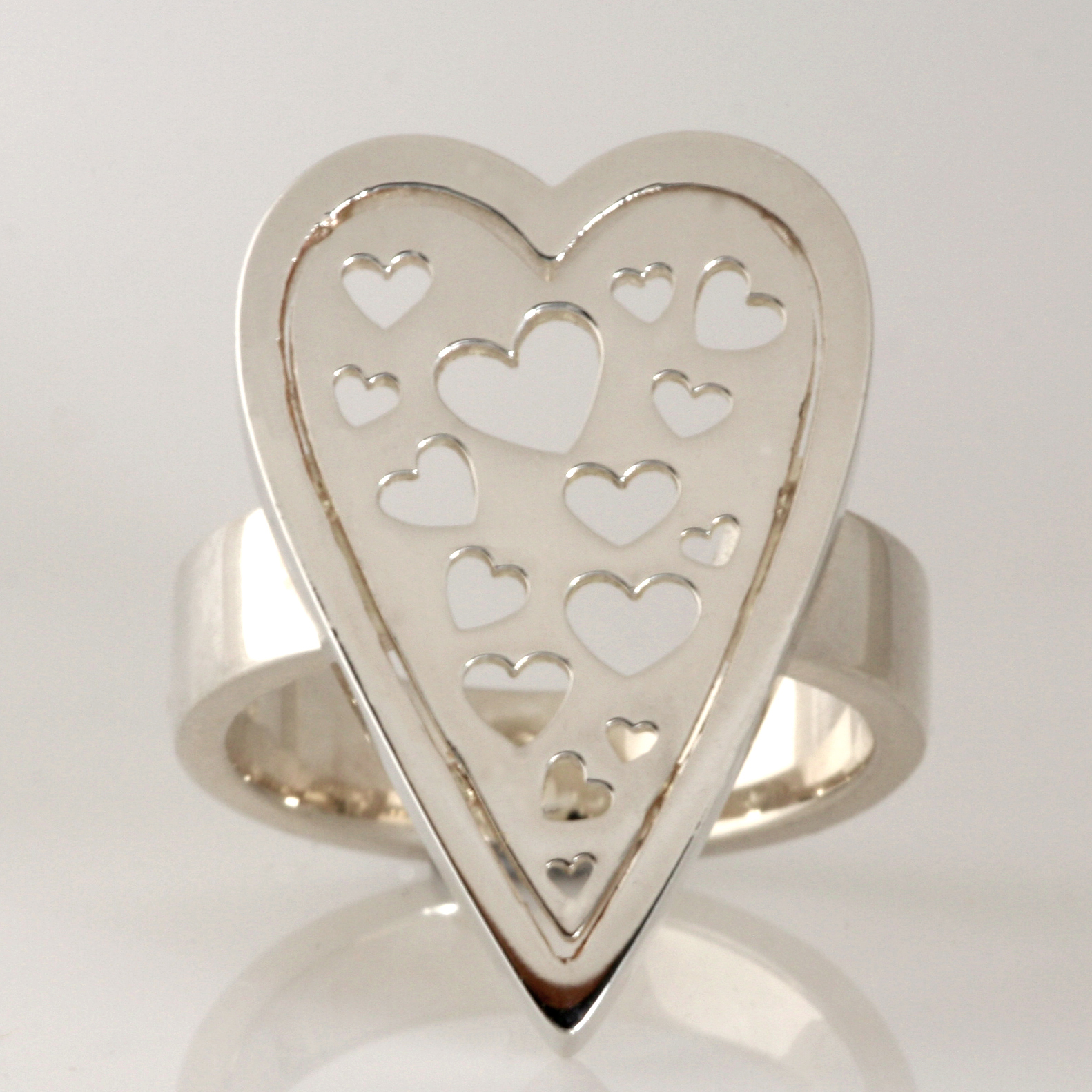 R102 sterling silver heart shape ring with heart shapes cut out. $160