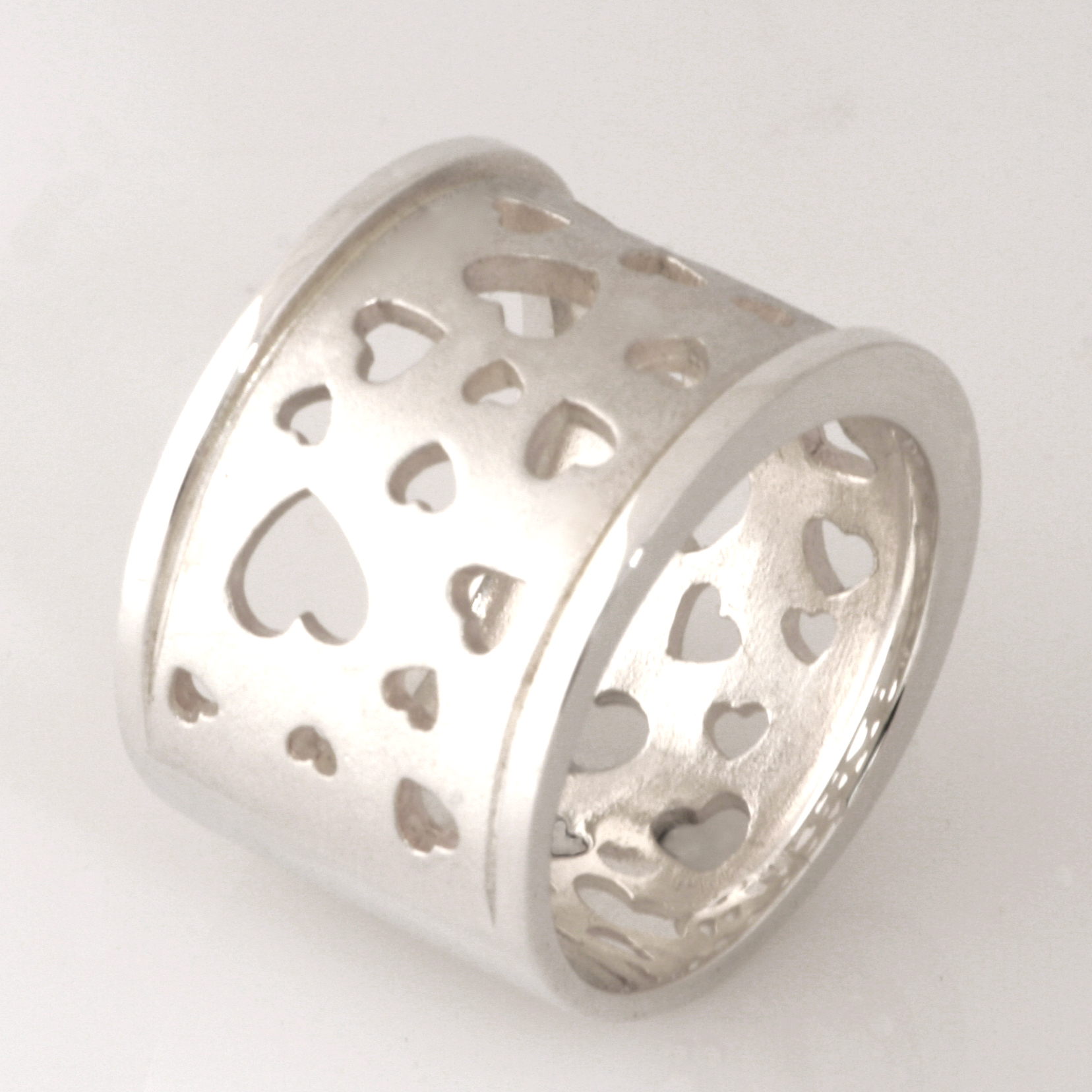 R107 Sterling silver thick band with heart shape cut outs. $135