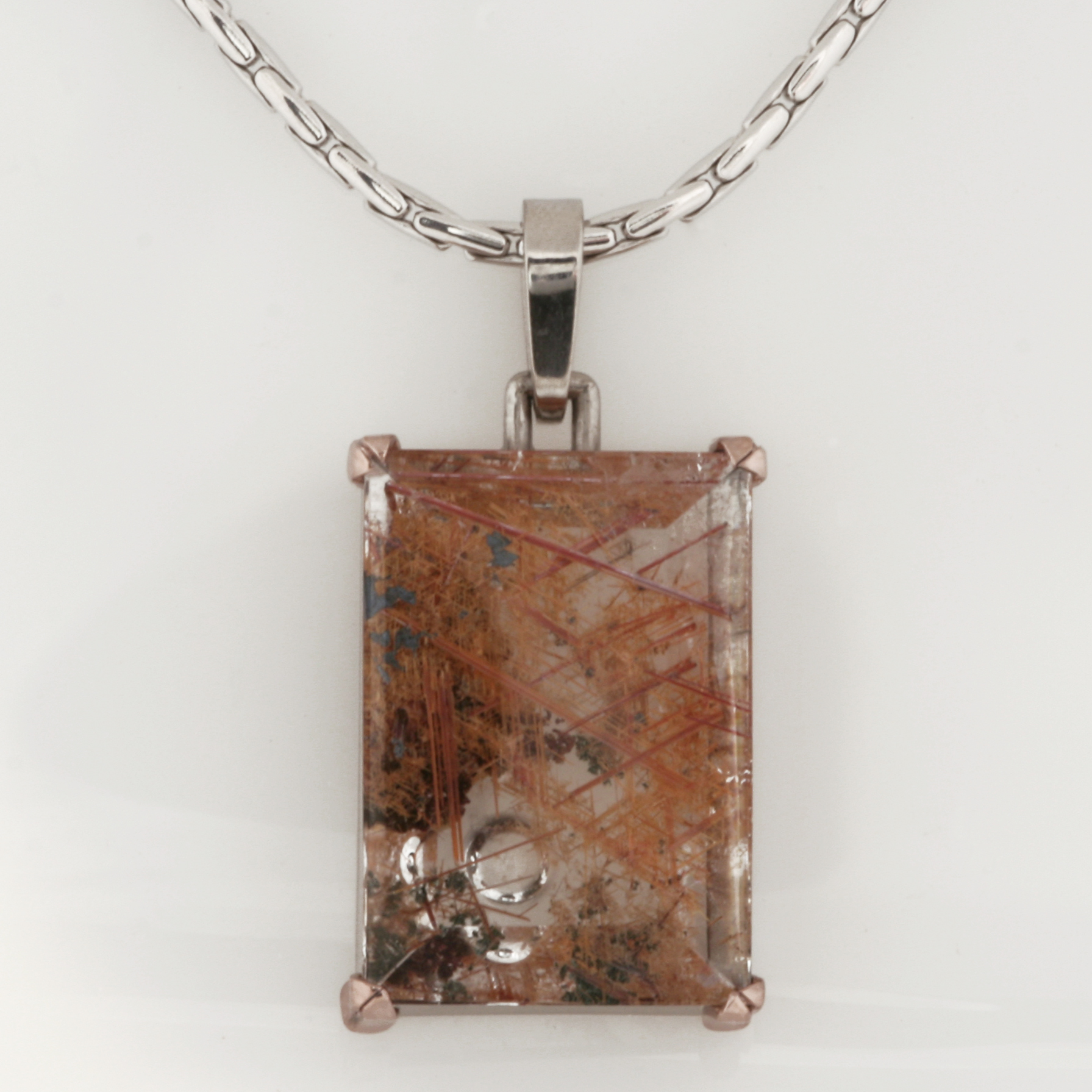 Handmade ladies palladium and 18ct rose gold pendant featuring a Rock Crystal with Rutile