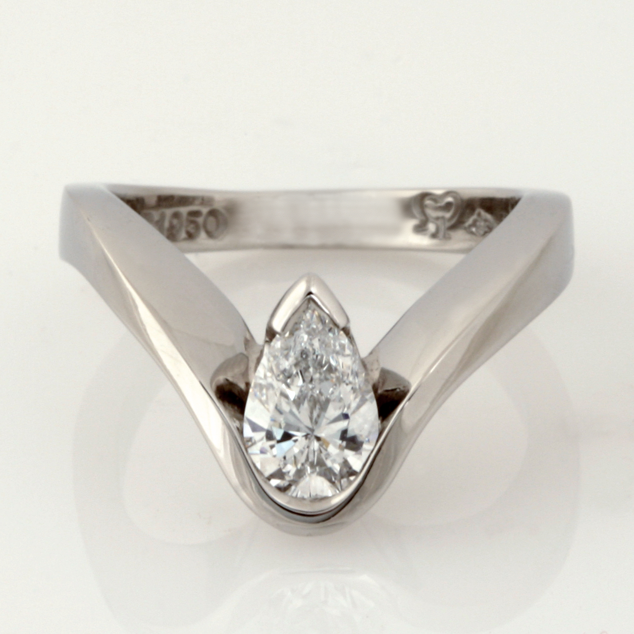 Handmade ladies palladium pear cut diamond engagement ring
