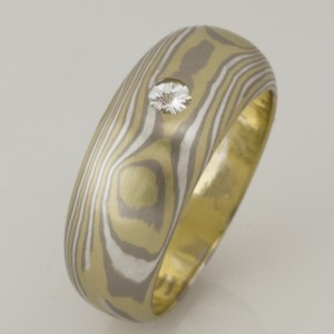 Handmade 18ct green & white gold and sterling silver Mokume Gane ring featuring a 12pt Spirit diamond