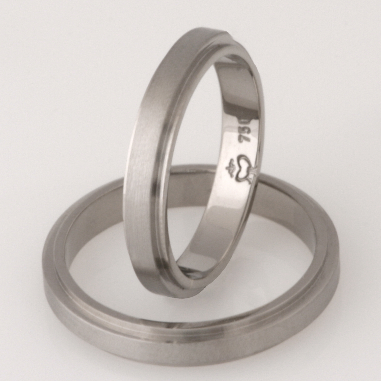 Handmade 18ct white gold matching wedding rings