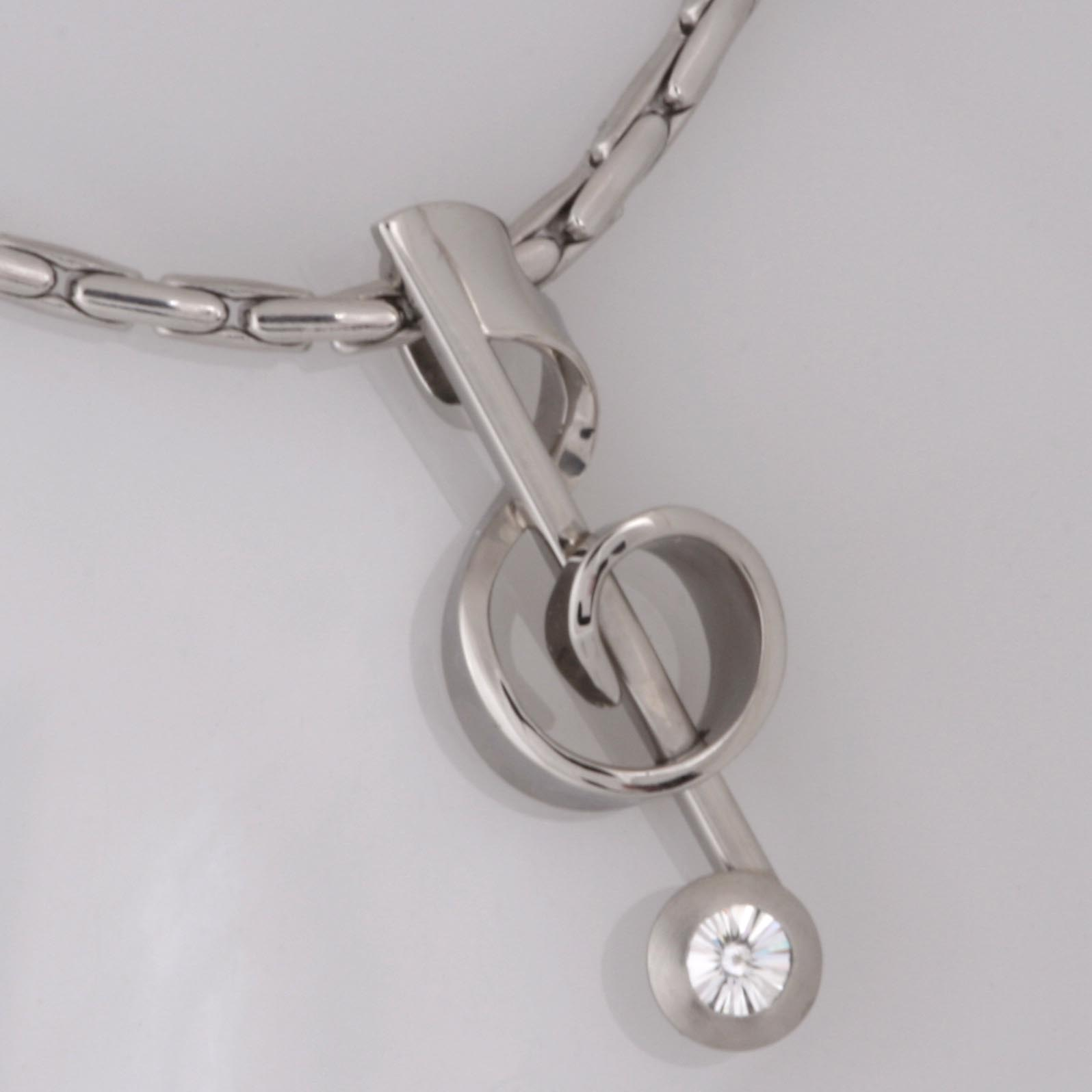 Handmade palladium Treble Clef pendant with a 'Spirit' cut diamond