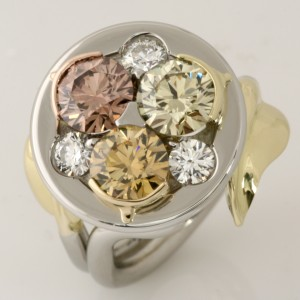 Handmade ladies Platinum and 18ct yellow, rose and green gold ring consisting of a Fancy Brown Yellow EightStar Diamond, a Fancy Brownish Greenish Yellow EightStar Diamond, a Fancy Brown Pink EightStar Diamond and three white EightStar Diamonds.