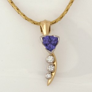Handmade ladies 18ct yellow, white gold and palladium tanzanite and diamond pendant on a 14ct yellow gold chain
