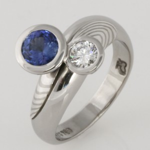 Handmade ladies palladium ceylon sapphire and diamond ring featuring 18ct white gold and sterling silver Mokume Gane.