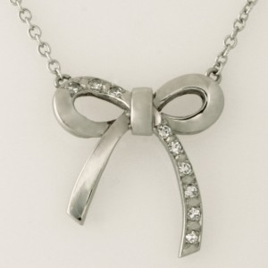 Handmade ladies palladium diamond bow pendant