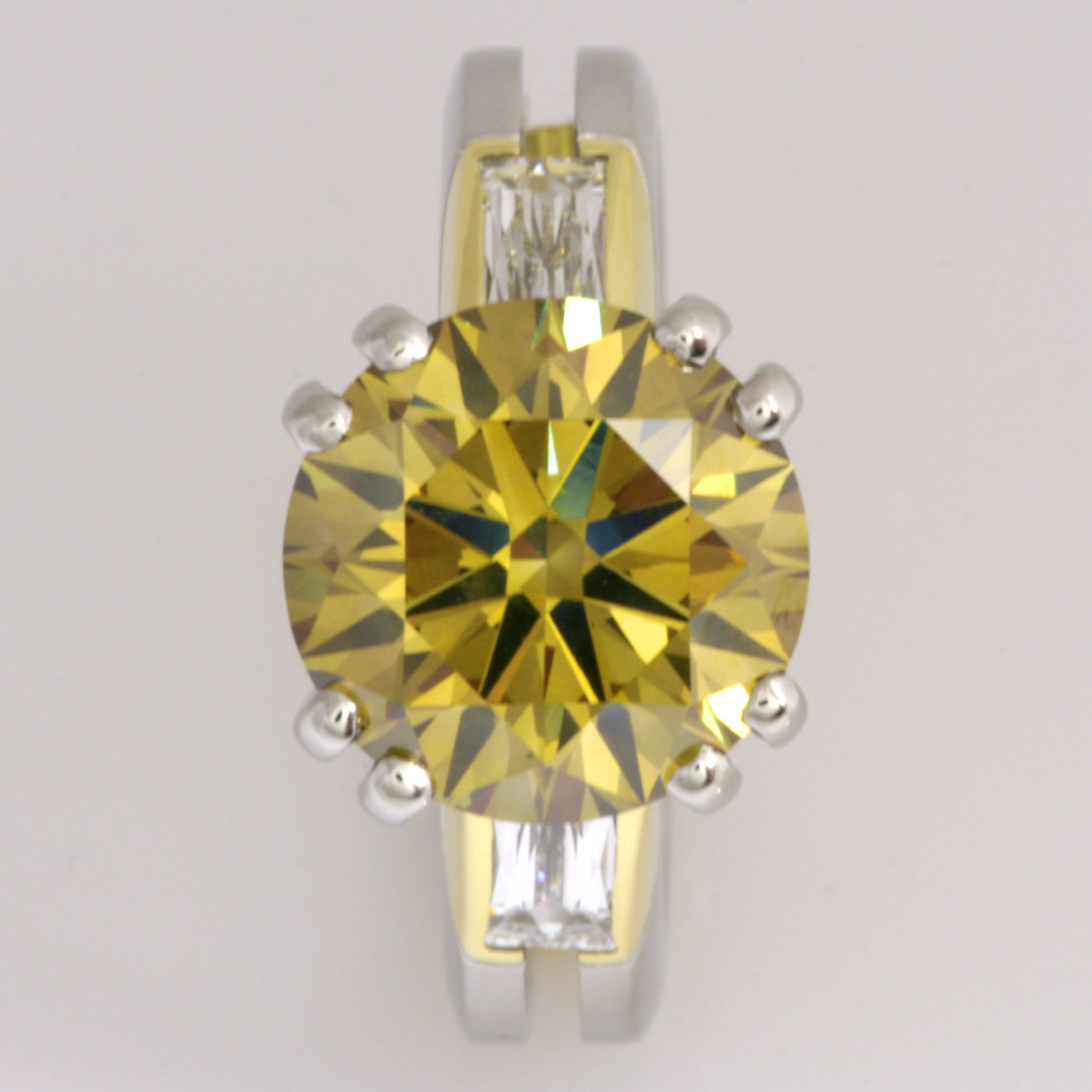 Handmade ladies platinum and 18ct green gold ring with a 5ct fancy deep brownish greenish yellow brilliant cut diamond in the centre with two shoulder matchbox 'tycoon' cut diamonds