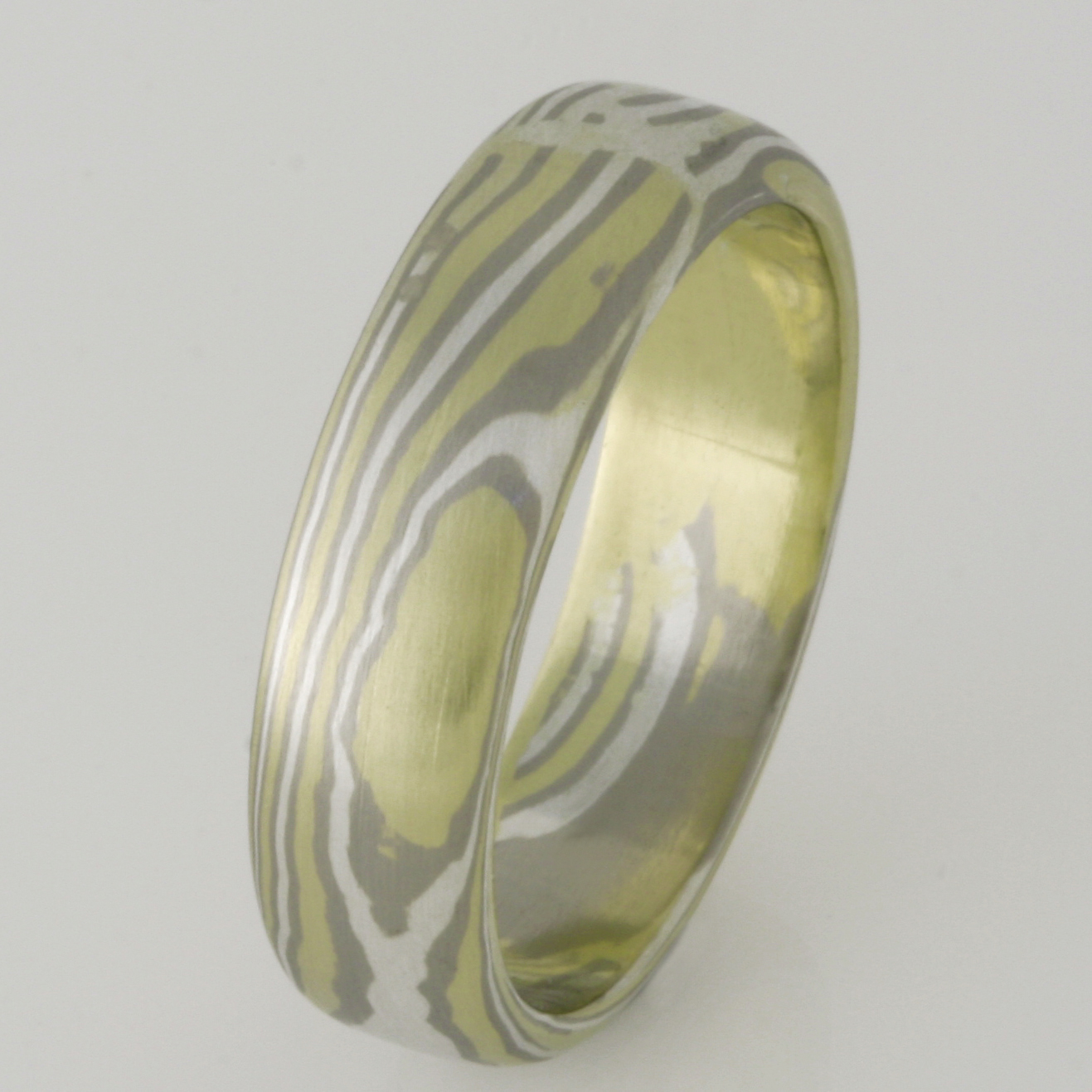 Handmade gents 18ct green, white and sterling silver Mokume Gane wedding ring.
