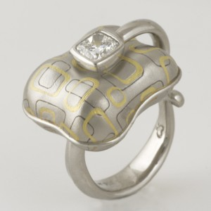 Handmade ladies 18ct rose and green gold, platinum and palladium patterned gold ring featuring a cushion cut diamond