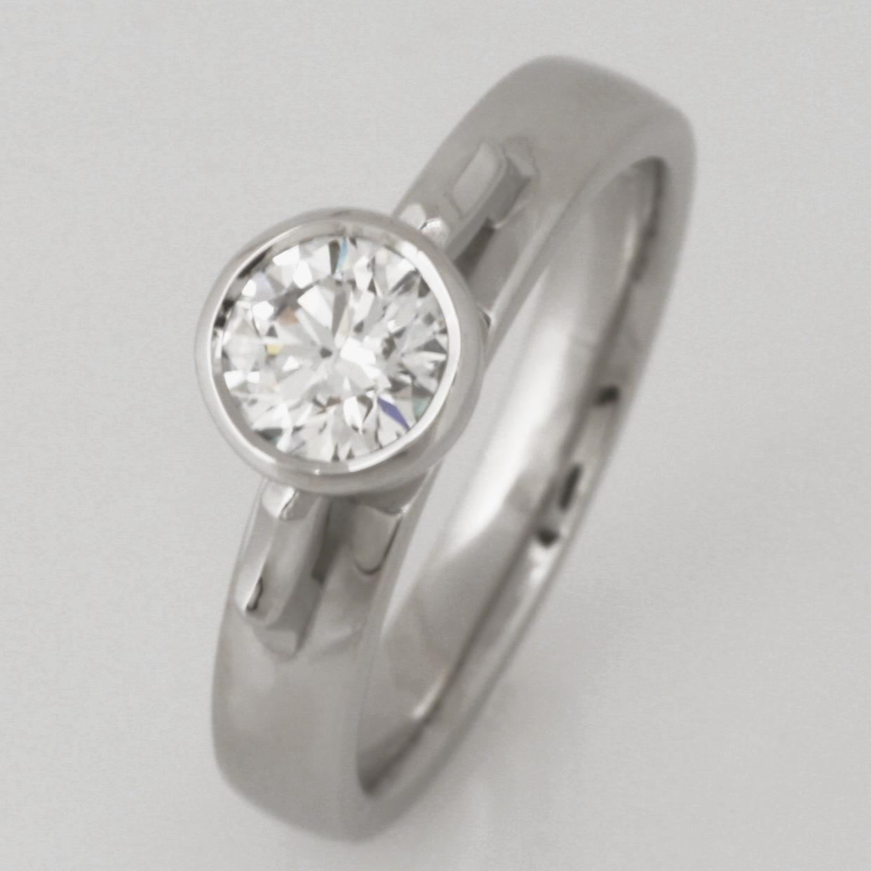 Handmade ladies palladium engagement ring featuring an Australian Argyle white diamond